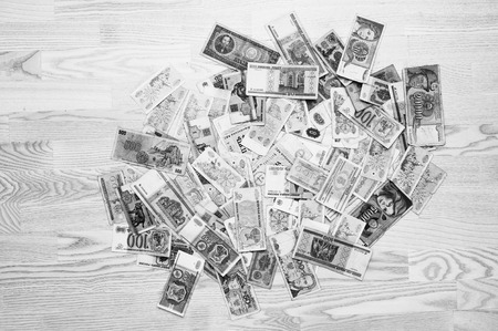 different countries: Many old money of different countries on wooden background