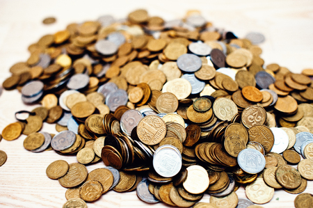pecuniary: Mountain coins on wooden background Stock Photo