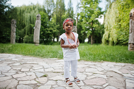 assent: Close up portrait of african baby girl walking at park