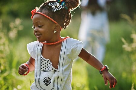 assent: African baby girl walking at park Stock Photo