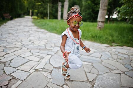 assent: Amazing beautiful african american baby girl with sunglasses having fun