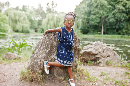 assent: Cute african american baby girl at sunglasses Stock Photo