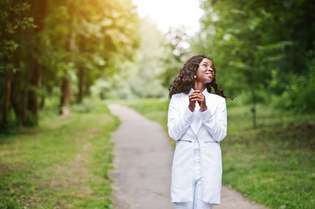 stay in green: Portrait of stylish black african american girl stay on path on green park
