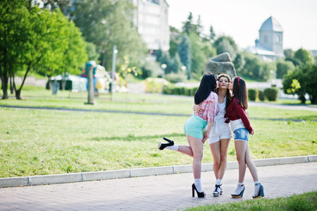 short shorts: Sexy girls on short shorts kissing their girlfriend on the cheek at bachelorette party