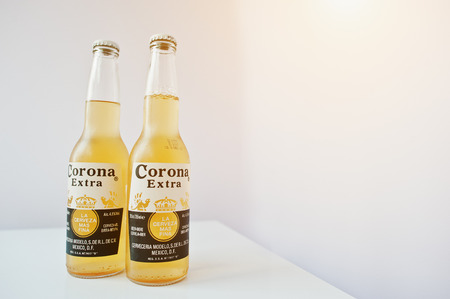 beers: Hai, Ukraine - June 29, 2016: Two bottles of Corona Extra, top  beers worldwide produced by Cerveceria Modelo in Mexico Editorial