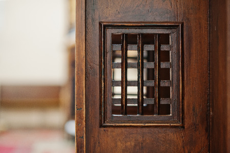 confess: Wooden window of confessional box at church