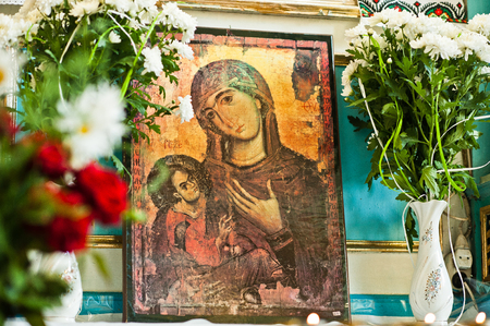 saintliness: Old wooden image icon of the Mother of God Mary and child Jesus Christ at church
