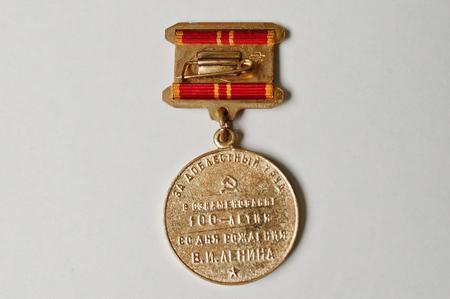 Soviet medal for the valiant work 100 anniversary of Lenins birth on white background