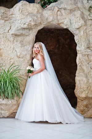 Elegant blonde blue eyes fashion bride at great wedding hall