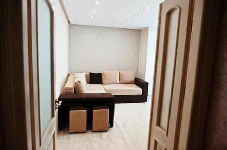 loveseat: Bicolor cofee corner sofa bed at light room
