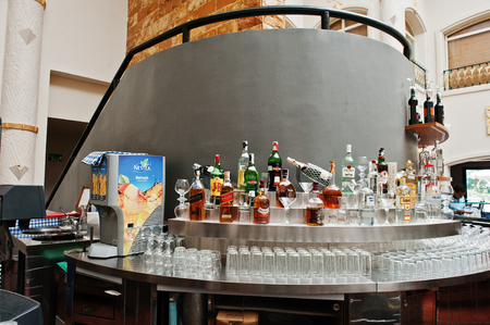 caribbean drink: Hurghada, Egypt -20 August 2016: Reception lobby bar with various alcohol drink in luxury hotel  resort Caribbean World Soma Bay