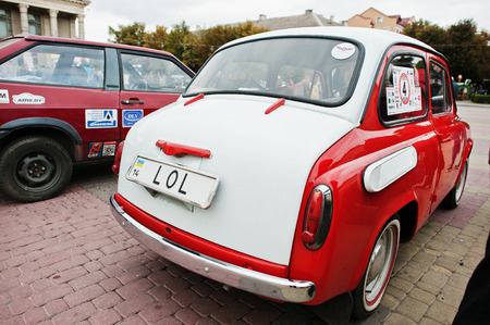Tarnopol, Ukraine - October 09, 2016: Classic retro car dual color white & red  ZAZ Zaporozhets 965 designed and built from 1960-1963, with license plate LOL
