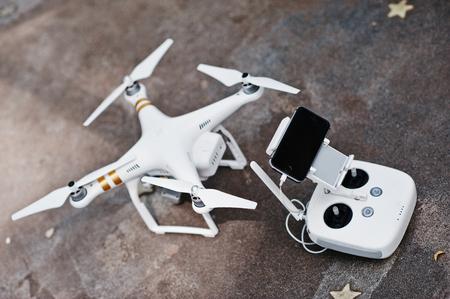 iv: Hai, Ukraine - October 20, 2016: DJI Phantom IV Pro drone quadcopter with remote control and gadget Editorial