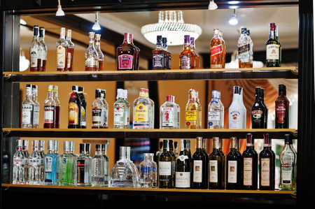 daniels: Hai, Ukraine - October 25, 2016: Several types of bottled alcohol are displayed on some shelves in a restaurant Editorial