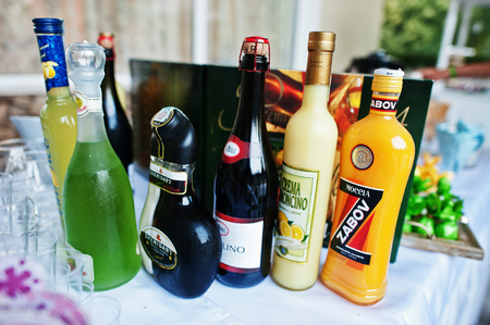 alcoholic beverages: Hai, Ukraine - October 25, 2016: Diferrent bottles of alcoholic beverages on the buffet table Editorial