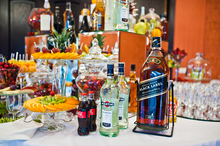 coke bottle: Hai, Ukraine - October 25, 2016: Large bottle of Black Label with Martini and Coke on the buffet table