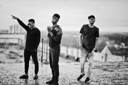 Three rap singers band on the roof. Black and white photo Stock Photo
