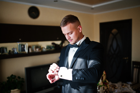 luxury watches: Man looking on luxury watches. Gathering of groom on wedding day. Stock Photo