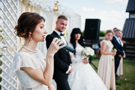 Master of ceremony speech on microphone background wedding couple.