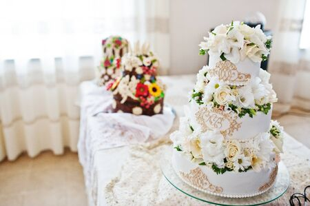 royal wedding: Royal wedding cake with flowers on table.