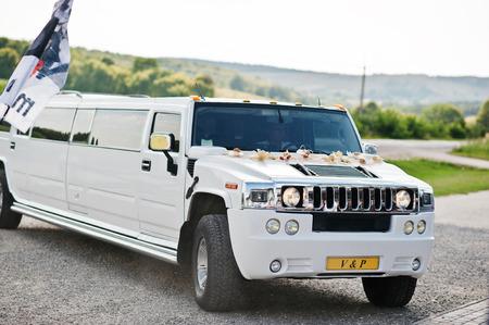 Kyiv, Ukraine - August 31: Elegance white wedding limousine Hummer H2 on wedding day. Editorial