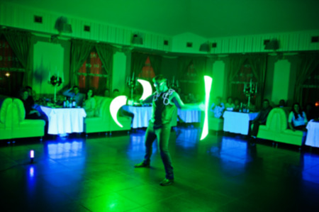 diode: Diode light show artists on wedding party. Blured photo. Stock Photo