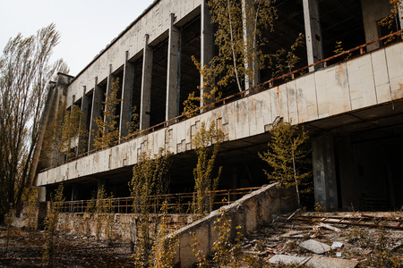 radiactividad: Chernobyl exclusion zone with ruins of abandoned pripyat city zone of radioactivity ghost town.