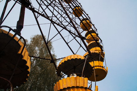 exclusion: Abadonrd ferris wheel in Pripyat ghost town in Chernobyl exclusion zone, Ukraine