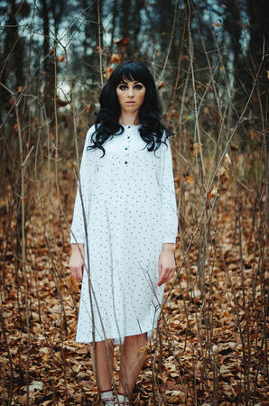 slump: Young sad lonely brunette girl at sleepwear