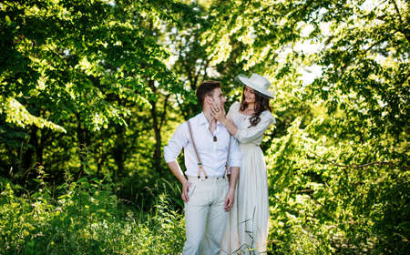 Handsome old fashioned retro couple outdoor green park with sunlight.