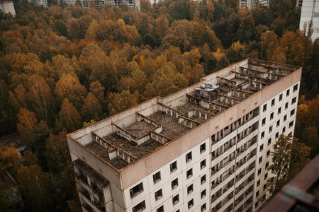 exclusion: Aerial panorama view of Chernobyl exclusion zone with ruins of abandoned pripyat city zone radioactivity ghost town with empty building.