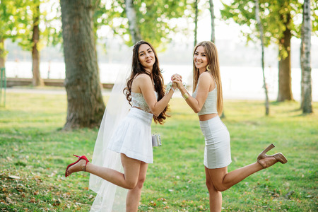 wedding feast: Two friends girls having fun on park at hen party. Stock Photo
