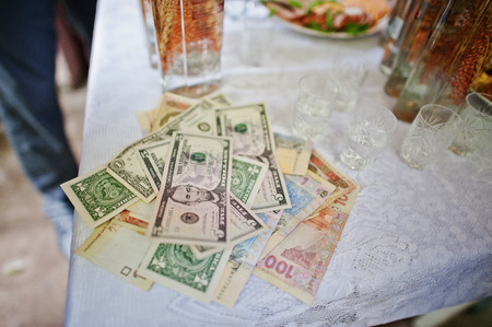 Different money at tradition of repurchase bride at wedding party.