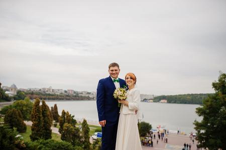 Wedding couple background city landscape panorama with lake.