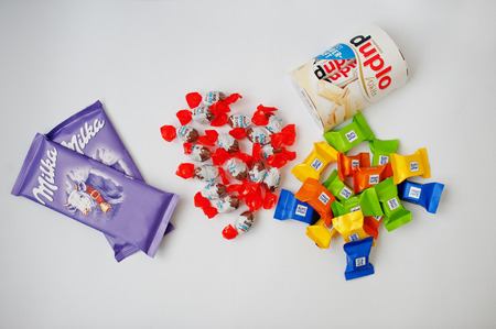 Dusseldorf, Germany - February 18, 2017: Different chocolates such as Milka, Ferrero Duplo, Kinder and Ritter Sport on white background. Editorial