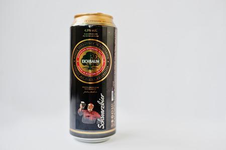 Dusseldorf, Germany - February 18, 2017: Iron bottles can of Eichbaum Schwarzbier beer on white background.