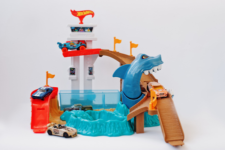 Hai, Ukraine - March 1, 2017: Hot wheels track with large shark and cars. Hot Wheels is a scale die-cast toy cars introduced by American toy maker Mattel in 1968.