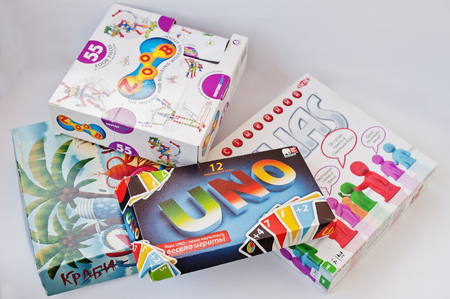 Hai, Ukraine - March 1, 2017: Different board games boxes such as Alias, Uno, Zoob, Crabs isolated on white. Editorial