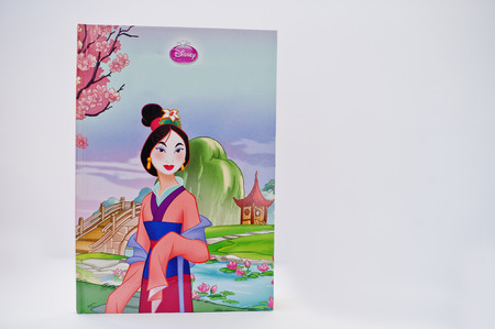 Hai, Ukraine - February 28, 2017: Animated Disney movies cartoon production book Mulan on white background.