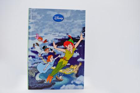 Hai, Ukraine - February 28, 2017: Animated Disney movies cartoon production book Peter Pan on white background.