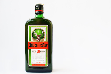 digest: Hai, Ukraine -14 March 2017: Jagermeister German digestif made with 56 herbs and spices isolated on white.
