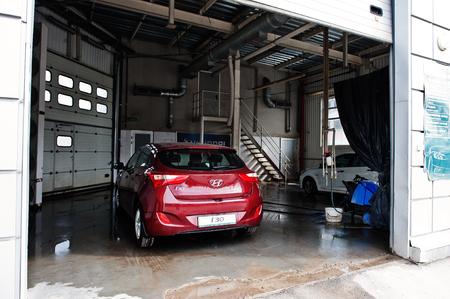 dirty car: Kiev, Ukraine - March 22, 2017: Red new Hyundai i30 at car wash.