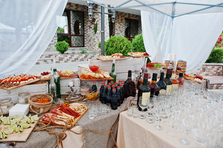 Wedding catering table with different foods and beverages.