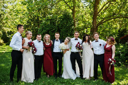 Elegance wedding couple with bridesmaids and best mans having fun. Crowd of friends on wedding. Ten people.