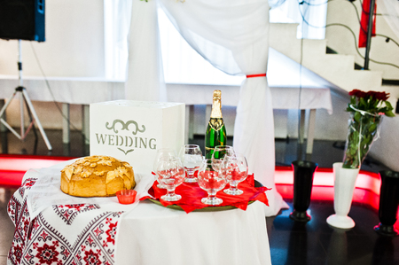 Table with champagne and glasses on wedding ceremony. Stock Photo