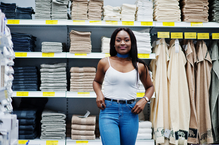shopper: Portrait of a fantastic woman with african american heritage walking in the store. Stock Photo