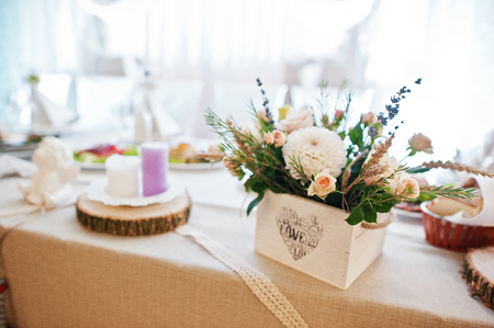 based: Fantastic flower compositions laying on a wedding table. Stock Photo