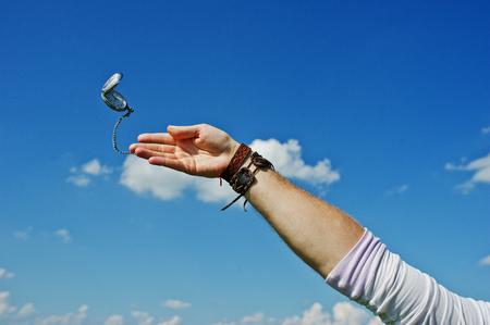 hands in pocket: Male hand throwing oldschool watch away.