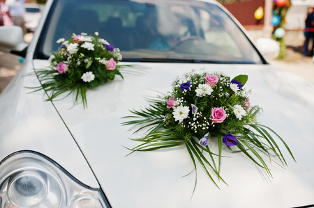 Awesome decorated with flowers white wedding suv.