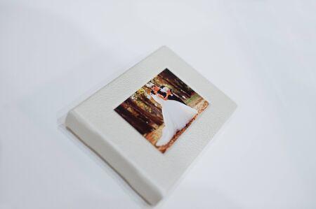 Sohisticated white leather wedding photobook or photo album on the white background. Stock Photo